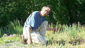 John Pierce weeds and nurtures the Native Prairie